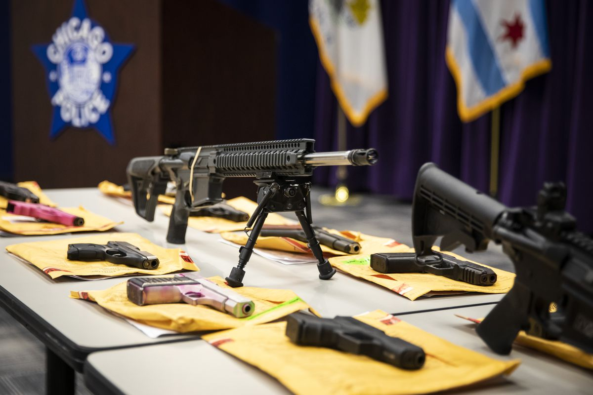 A table of guns Chicago Police say officers confiscated is displayed during a news conference at at police headquarters last year.