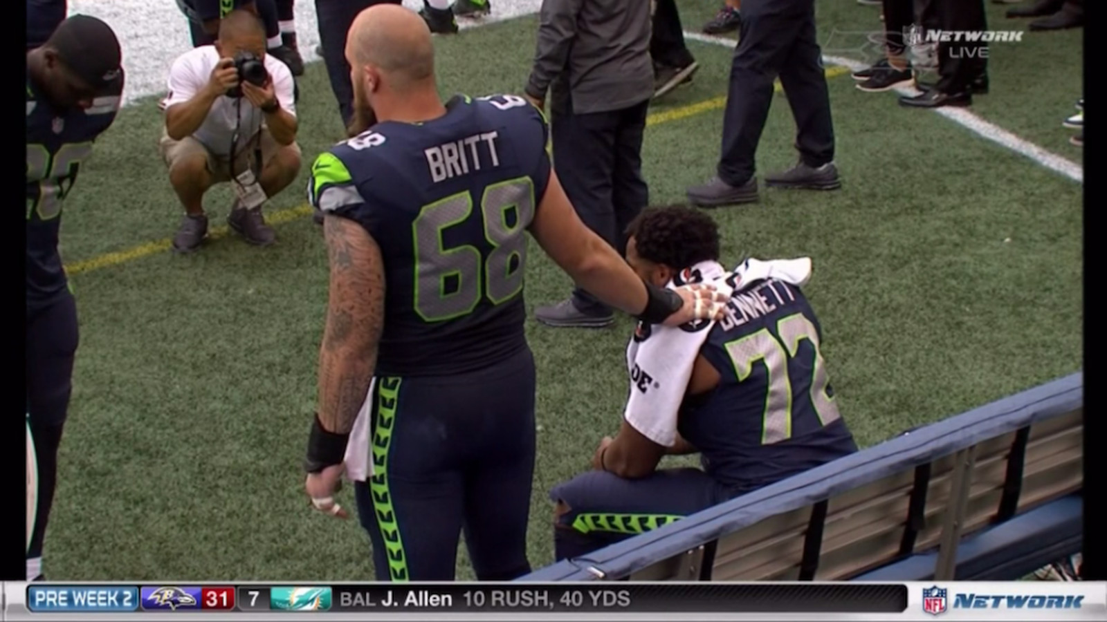 Justin Britt stands by Michael Bennett in support during national anthem protest