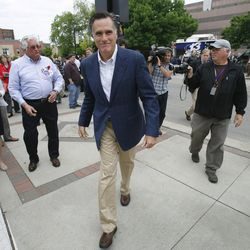 FILE - Former Massachusetts Gov. Mitt Romney heads to his car after speaking at the Mediacom 2012 Presidential Candidate Series May 27 in Des Moines, Iowa.