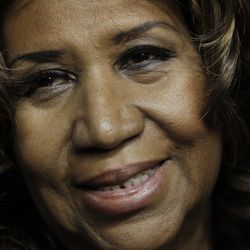 Aretha Franklin smiles after the Detroit Pistons-Miami Heat game in 2011. | AP Photo/Paul Sancya