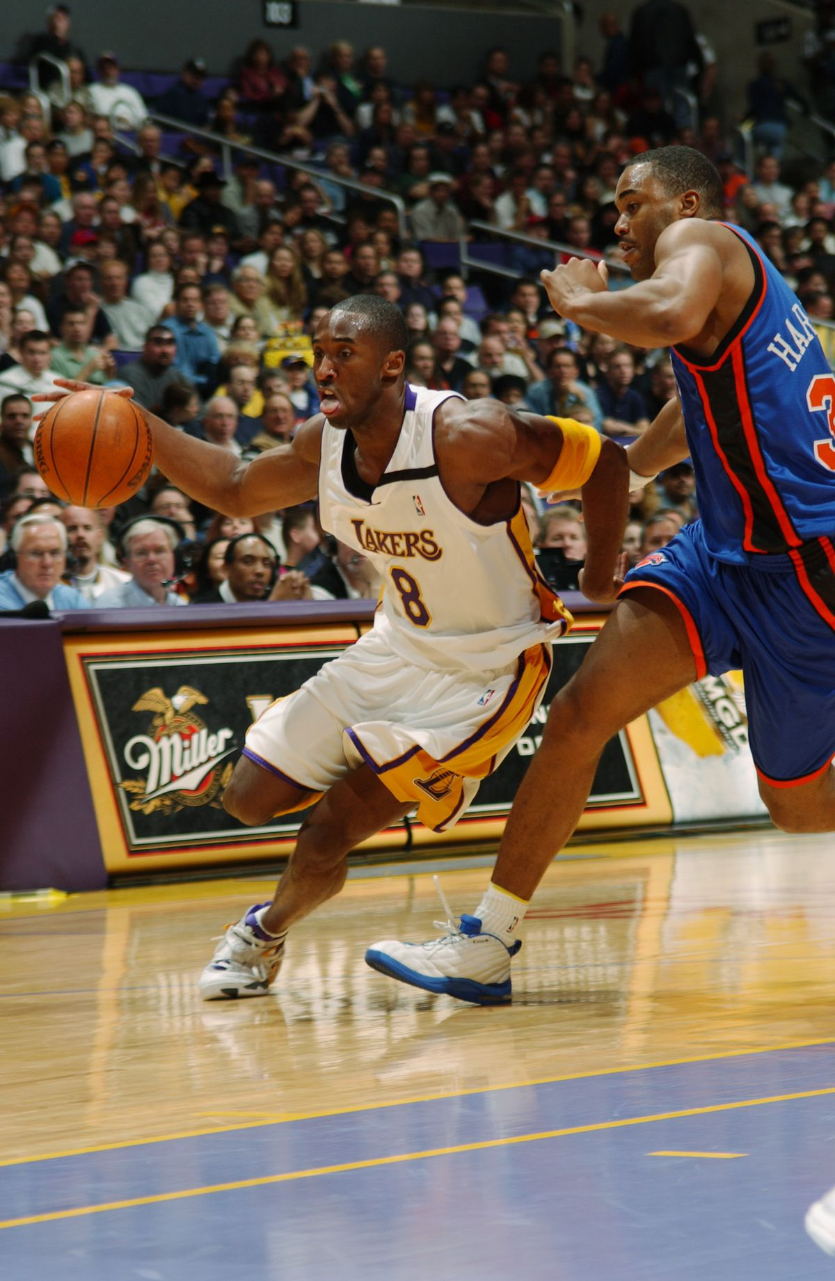 Kobe Bryant drives around Othella Harrington