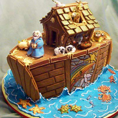 A gingerbread ark on water with animals in pairs.