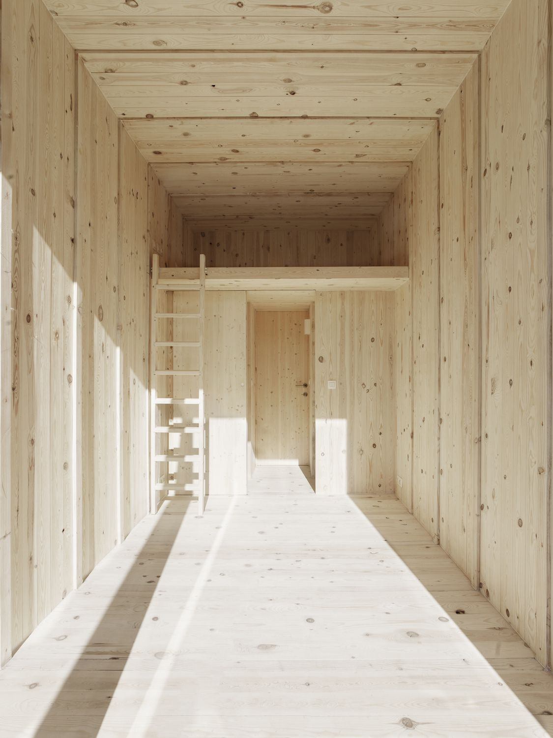 Interior of home clad in white oiled pined.