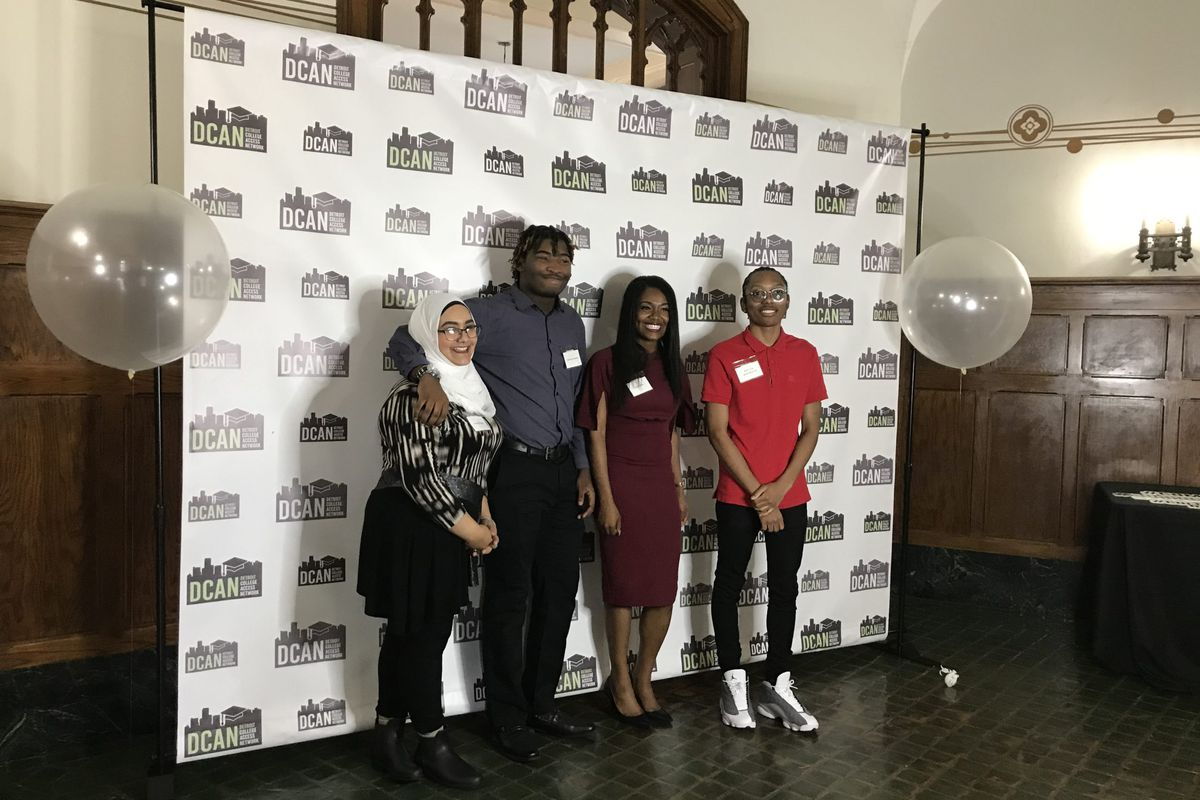From left, America Yahya, De'Ernst Johnson, Myla Smith, and Anton Bronson pose for a photo after participating in a panel discussion about college success.