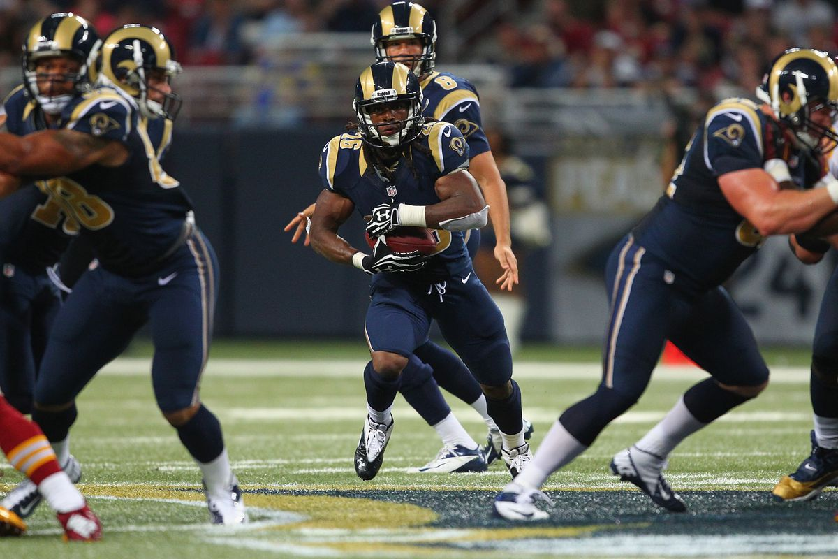 ST. LOUIS, MO - SEPTEMBER 16: Daryl Richardson #26 of the St. Louis Rams rushes against the Washington Redskins at the Edward Jones Dome on September 16, 2012 in St. Louis, Missouri.  (Photo by Dilip Vishwanat/Getty Images)