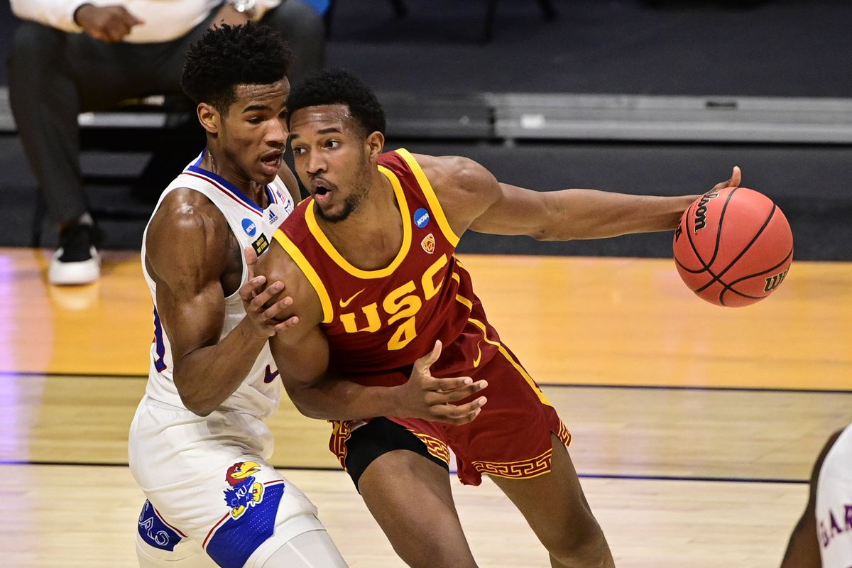 Southern California Trojans forward Evan Mobley handles the ball while Kansas Jayhawks guard Ochai Agbaji defends during the first half in the second round of the 2021 NCAA Tournament at Hinkle Fieldhouse.