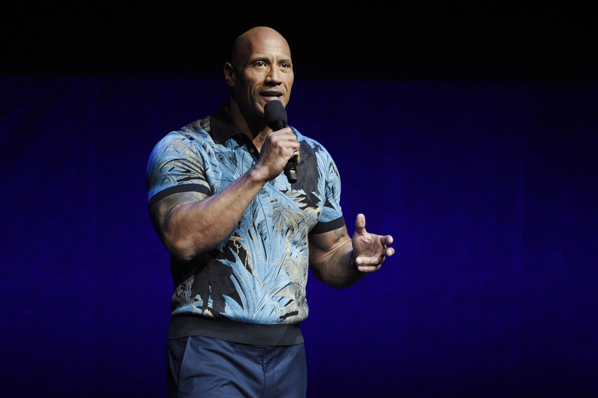 In this Wednesday, April 3, 2019, file photo, Dwayne Johnson speaks during the Universal Pictures presentation at CinemaCon 2019, the official convention of the National Association of Theatre Owners (NATO) at Caesars Palace, in Las Vegas. Johnson says he and his family tested positive for the coronavirus. Johnson announced their diagnosis in an 11-plus minute video on Instagram on Wednesday, Sept. 2, 2020.