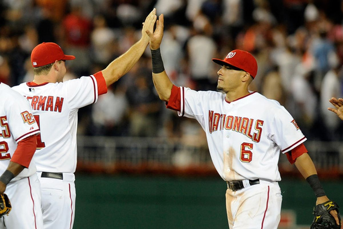 WASHINGTON - JULY 27:  Ian Desmond #6 and Ryan Zimmerman #11 of the Washington Nationals celebrate after a 3-0 victory against the Atlanta Braves at Nationals Park on July 27 2010 in Washington DC.  (Photo by Greg Fiume/Getty Images)