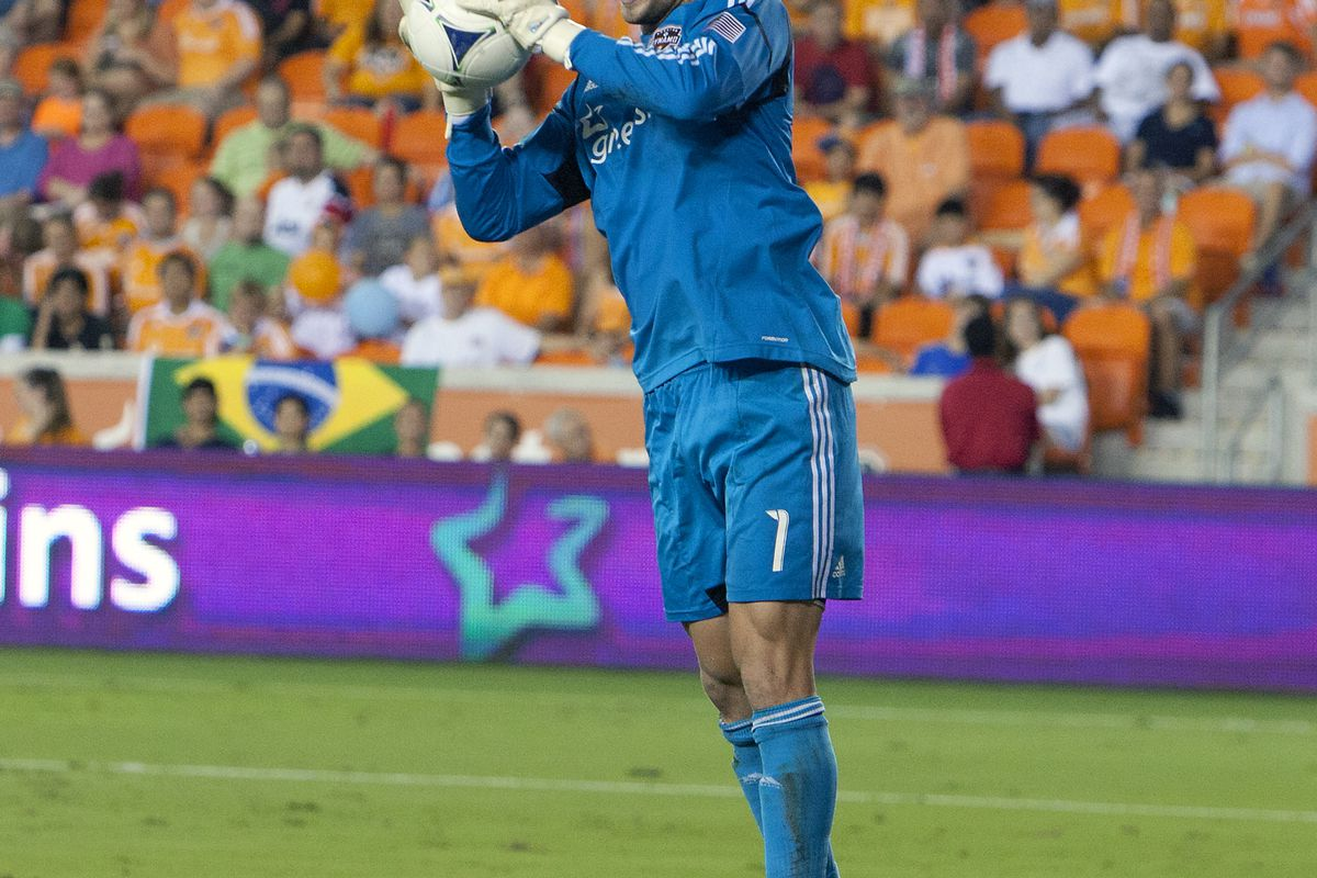HOUSTON, TX - AUGUST 19:  Tally Hall #1 of the Houston Dynamo makes save against the Columbus Crew in the second half at BBVA Compass Stadium on August 19, 2012 in Houston, Texas.  (Photo by Bob Levey/Getty Images)