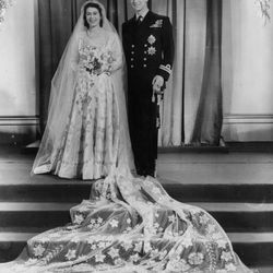 All hail the Queen — and her wedding dress. This opulent satin gown, created for Princess Elizabeth's November 20th, 1947 marriage to Prince Philip, was custom made by Norman Hartnell with motifs of star lilies and orange blossoms.