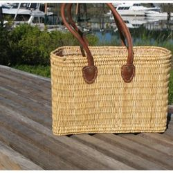 """Pretend you're on vacation in the French countryside while carrying <a href=""""http://www.maisondekristine.com/french_market_basket_fw2"""" rel=""""nofollow"""">Maison de Kristine's long-handled french tote</a> ($44)"""
