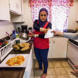 Kholoud Abou Arida prepares dinner for her children at her home in Millcreek on Tuesday, Sept. 8, 2015.