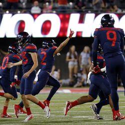 Arizona celebrates recovering an onside kick against Utah in Tucson, Arizona, on Friday, Sept. 22, 2017. Utah beat Arizona 30-24.