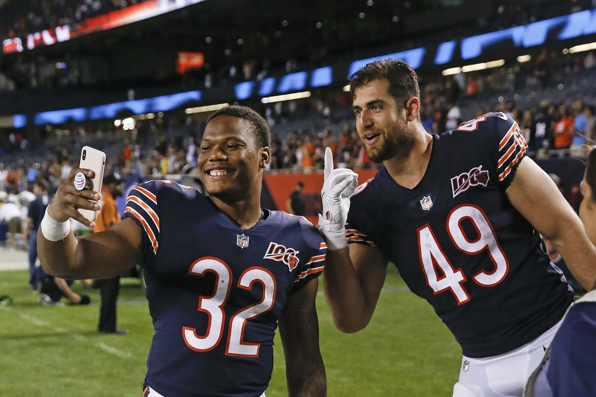 Running back David Montgomery (left) needs to go from good to great this season for the Bears' offense to have a chance.