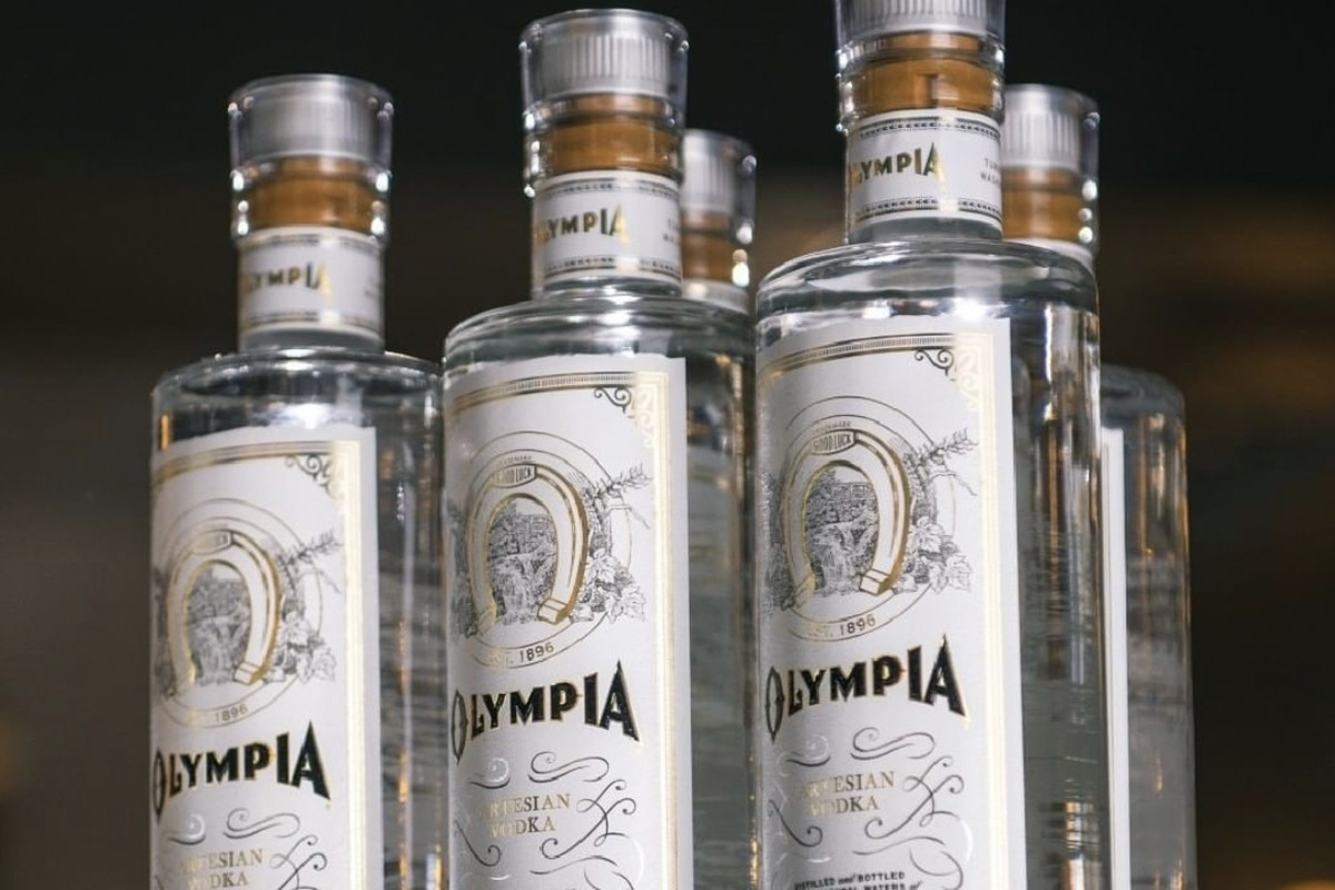 Five bottles of Olympia Artesian Vodka lined up next to each other