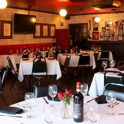 """The old neon sign at the original Campisi's on Mockingbird Lane says """"Egyptian Food"""", but don't be fooled--its been serving straight up red sauce Italian since 1946. (Jack Ruby was a regular.)  The dark, slightly dingy dining room with newspaper-covered w"""