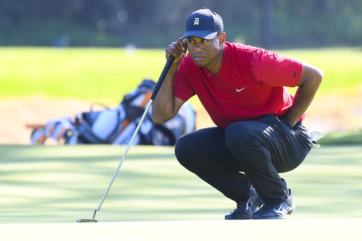 Tiger Woods lines up a putt on 7th hole during the final round of The Genesis Invitational golf tournament at the Riviera Country Club in Pacific Palisades, CA.