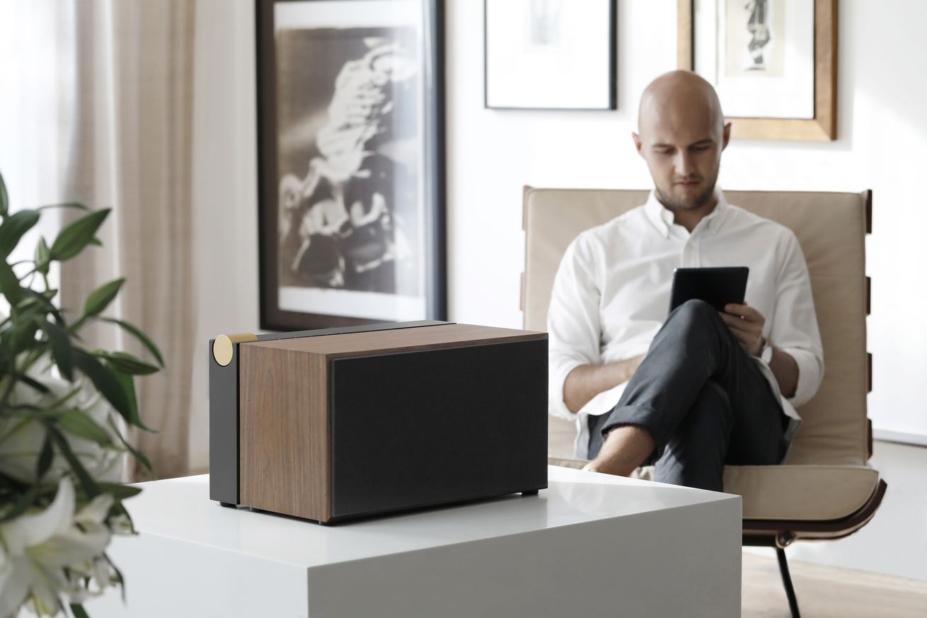 this fancy speaker features a hidden tech drawer and qi charging