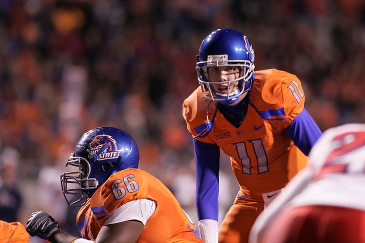 BOISE ID - NOVEMBER 19:  Kellen Moore #11 of the Boise State Broncos calls the play against the Fresno State Bulldogs at Bronco Stadium on November 19 2010 in Boise Idaho.  (Photo by Otto Kitsinger III/Getty Images)