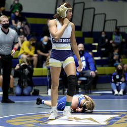 Celeste Detoles of Westlake stands up after pinning Bryton Moore of Pleasant Grove as they wrestle in class 120 as girls compete for the 6A State Wrestling championship at West Lake High in Saratoga Springs on Monday, Feb. 15, 2021.