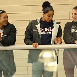 UConn's Napheesa Collier, Gabby Williams and Katie Lou Samuelson watch the USA Basketball practice.