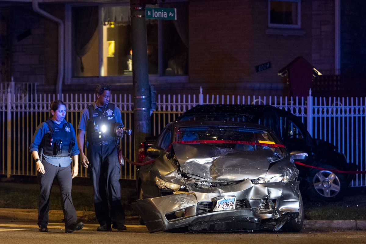 Chicago police work the scene of a vehicle accident where a 17-year-old and a 16-year-old boy was seriously injured after a 30-year-old man ran a red light and struck them in the 4400 block of West Peterson Ave, in the Sauganash neighborhood, Saturday, June 26, 2021.   Tyler LaRiviere/Sun-Times