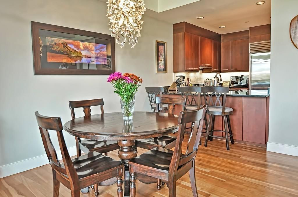 A dining room area with a round table and chairs.