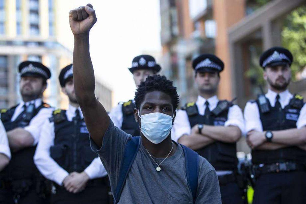 Black man and cops