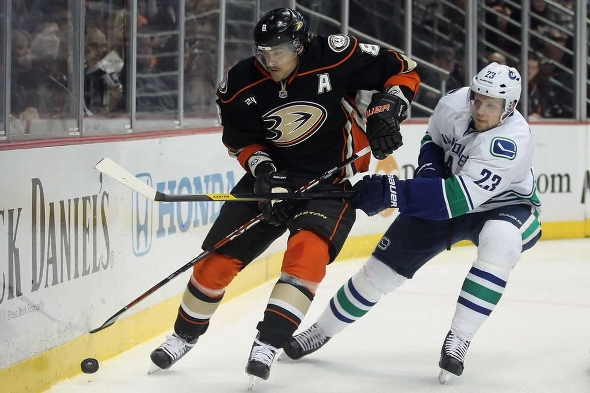 ANAHEIM, CA - NOVEMBER 11:  Teemu Selanne #8 of the Anaheim Ducks is pursued by Alexander Edler #23 of the Vancouver Canucks in the first period at Honda Center on November 11, 2011 in Anaheim, California.  (Photo by Jeff Gross/Getty Images)