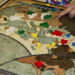Players move their cube armies around the world in an attempt to gain regions and resources in Rise of Empires, from Mayfair Games.