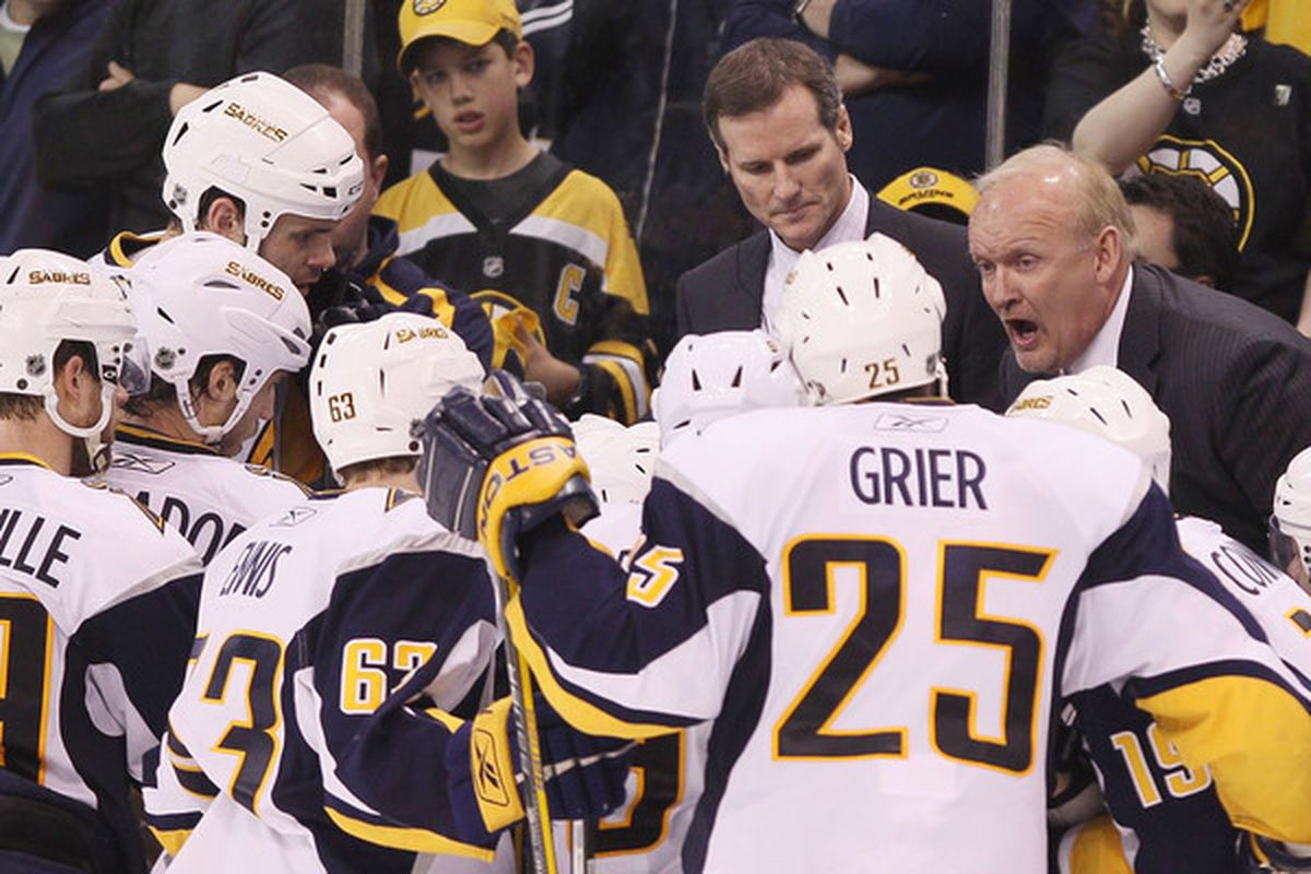 <strong>Boss's orders:</strong> Lindy Ruff hands out instructions to his players, who listen intently.