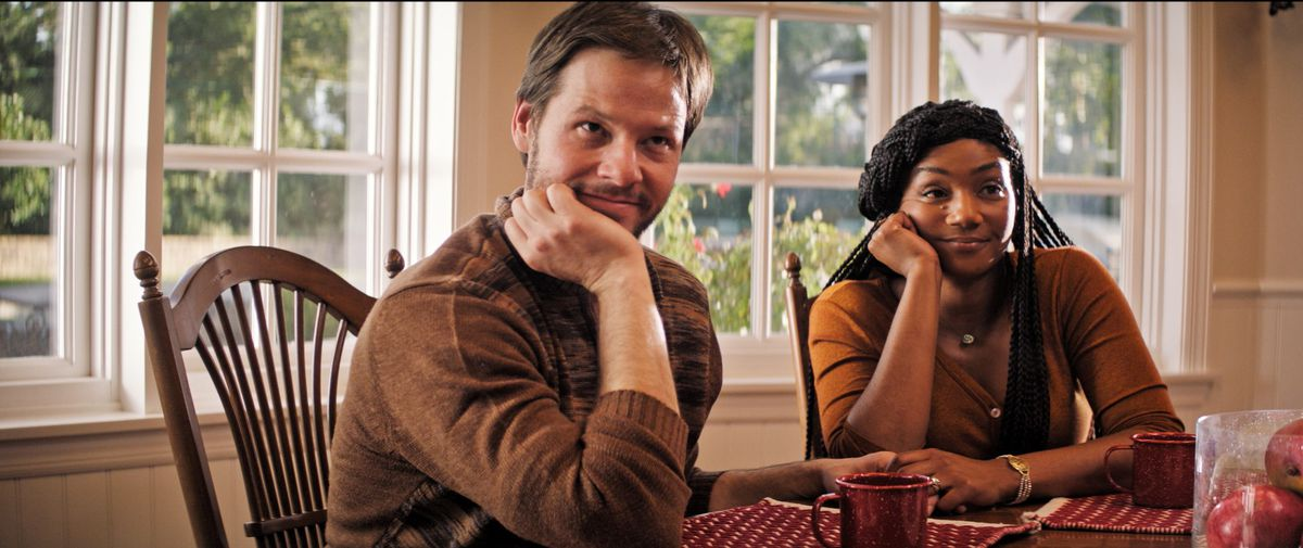 """Chris (Ike Barinholtz) and wife Kai (Tiffany Haddish) are in for a rambunctious Thanksgiving dinner in """"The Oath."""" 