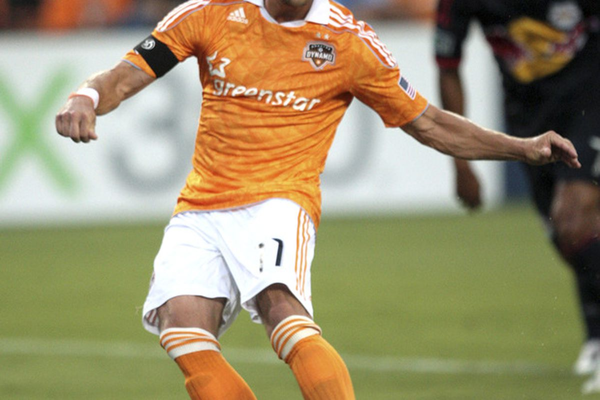 HOUSTON - MAY 21: Brad Davis #11 of the Houston Dynamo scores on a penalty kick in the first half against the New York Red Bulls at Robertson Stadium on May 21, 2011 in Houston, Texas. (Photo by Bob Levey/Getty Images)