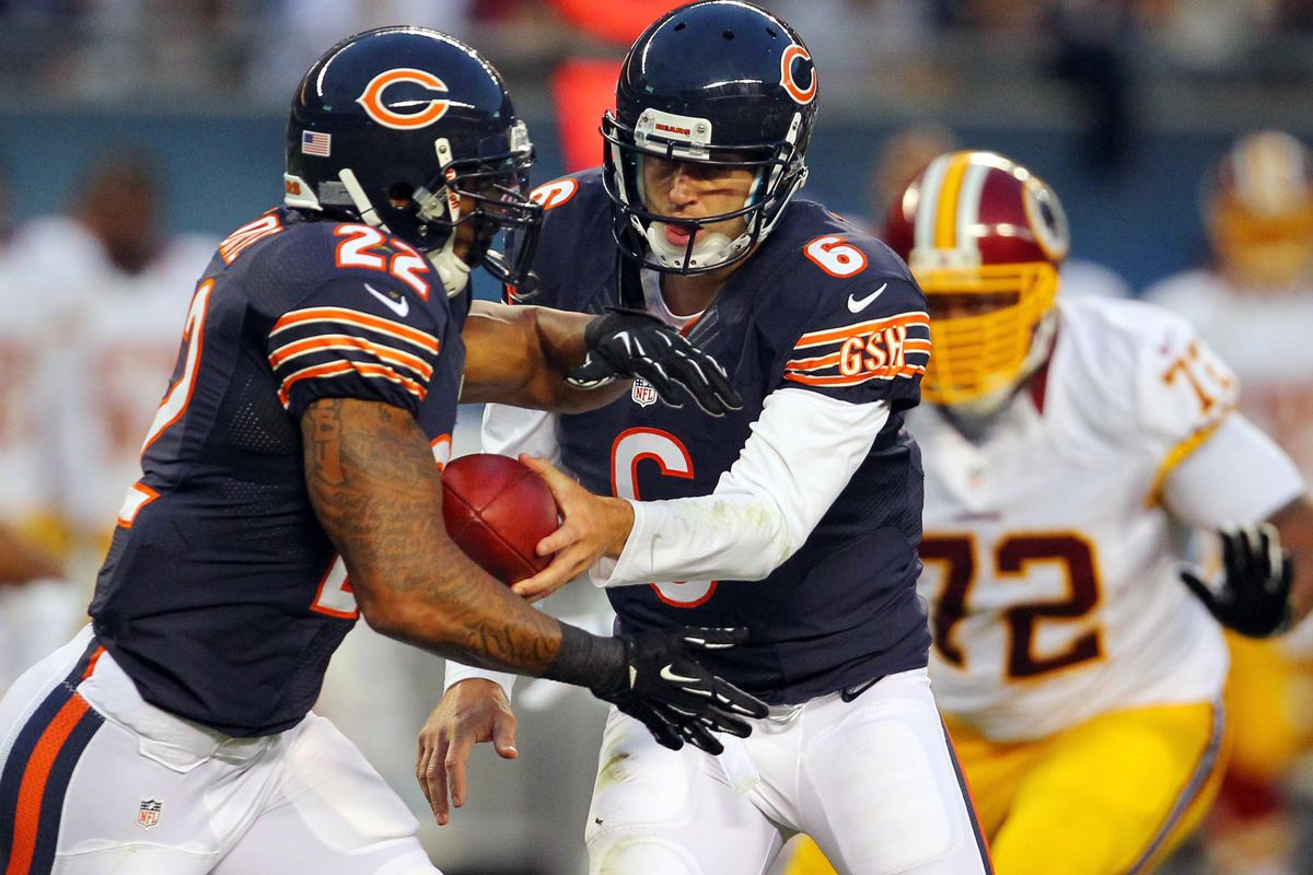 Aug 18, 2012; Chicago, IL, USA; Chicago Bears quarterback Jay Cutler (right) hands off to running back Matt Forte (left) during the second quarter against the Washington Redskins at Soldier Field. Mandatory Credit: Dennis Wierzbicki-US PRESSWIRE