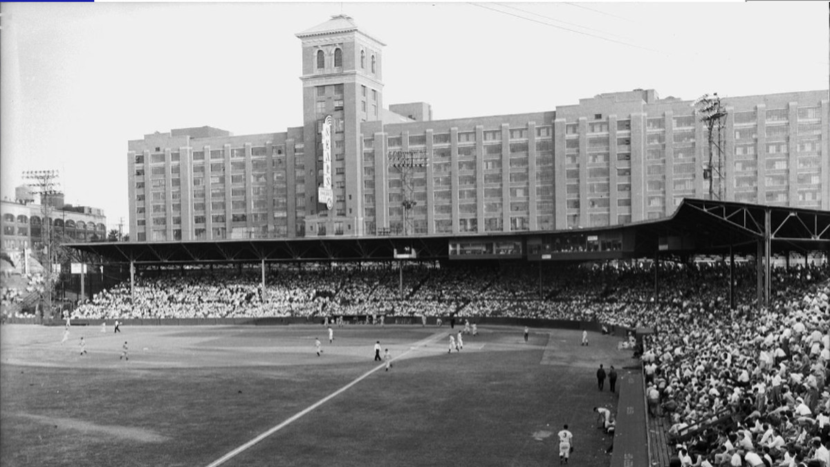 A black and white photo of an old baseball game.