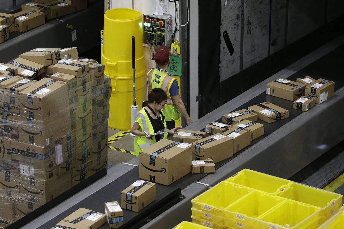 Packages move down a conveyor system were they are directed to the proper shipping area at the new Amazon Fulfillment Center in Sacramento, Calif.
