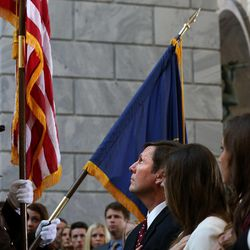 Stan Lockhart, husband of former Speaker of the House Rebecca Lockhart, salutes the American flag during the national anthem at the memorial service for Speaker Lockhart in the Capitol rotunda in Salt Lake City on Thursday, Jan. 22, 2015. Rebecca Lockhart died at her home in Provo on Jan. 17, 2015, from a rare brain disease.