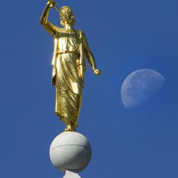 The moon is set to the side of the Angel Moroni atop the Salt Lake Temple during the Saturday morning session of General conference Saturday, Oct. 6, 2012.