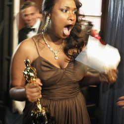 """FILE - In this Feb. 25, 2007 file photo, Jennifer Hudson reacts  backstage after winning best supporting actress for her work in """"Dreamgirls"""" during the 79th Academy Awards in Los Angeles. More accustomed to walking a red carpet in Vera Wang ballgowns, performing at the Grammy Awards or autographing her new book about weight-loss, the Oscar-winning actress and singer's next public appearance won't be glamorous. The starlet will be under a whole different spotlight in April 2012 in Chicago when she is expected to attend the triple murder trial of the man accused of killing her mother, brother and nephew."""