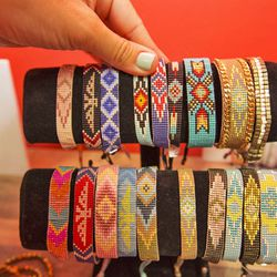 These beaded bracelets are handmade on a loom and feature leather backing.