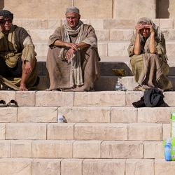"""Extras sit on steps between scenes during filming of a faith-based streaming series on the life of Jesus Christ called """"The Chosen"""" at The Church of Jesus Christ of Latter-day Saints' Jerusalem set in Goshen, Utah County, on Monday, Oct. 19, 2020."""