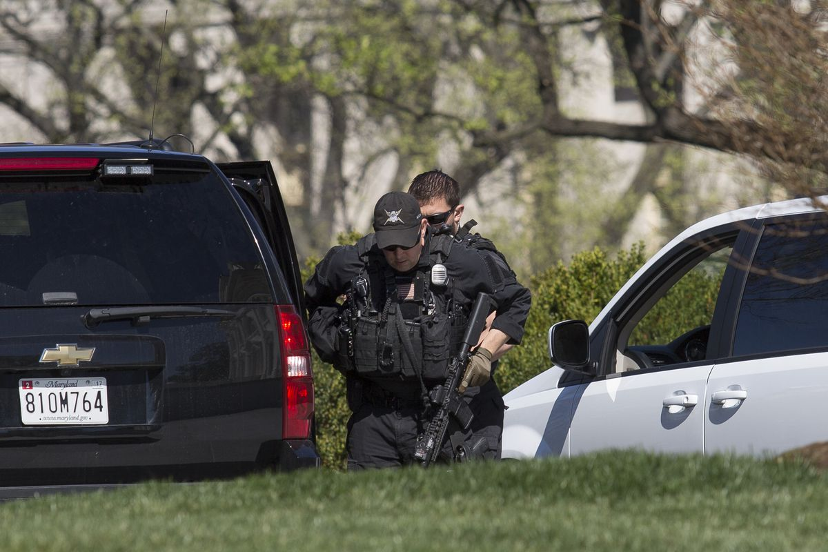 Secret Service agents walk outside of the White House on Monday after a gunman reportedly shot a Capitol police officer.