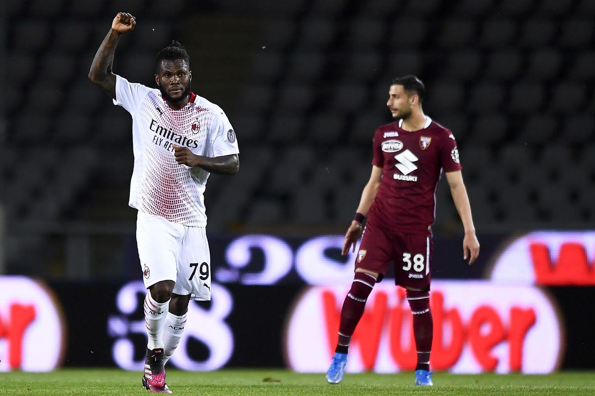 Franck Kessie (L) of AC Milan celebrates after scoring a...