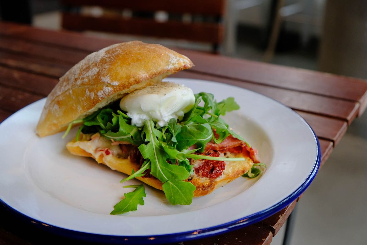 An egg sandwich with greens at Bounty Kitchen.