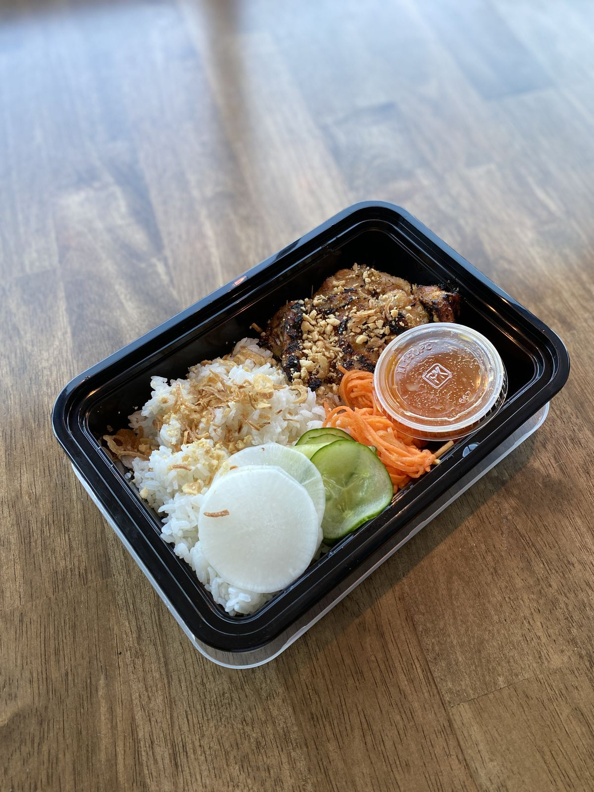 A lemongrass chicken rice bowl from Emilie's