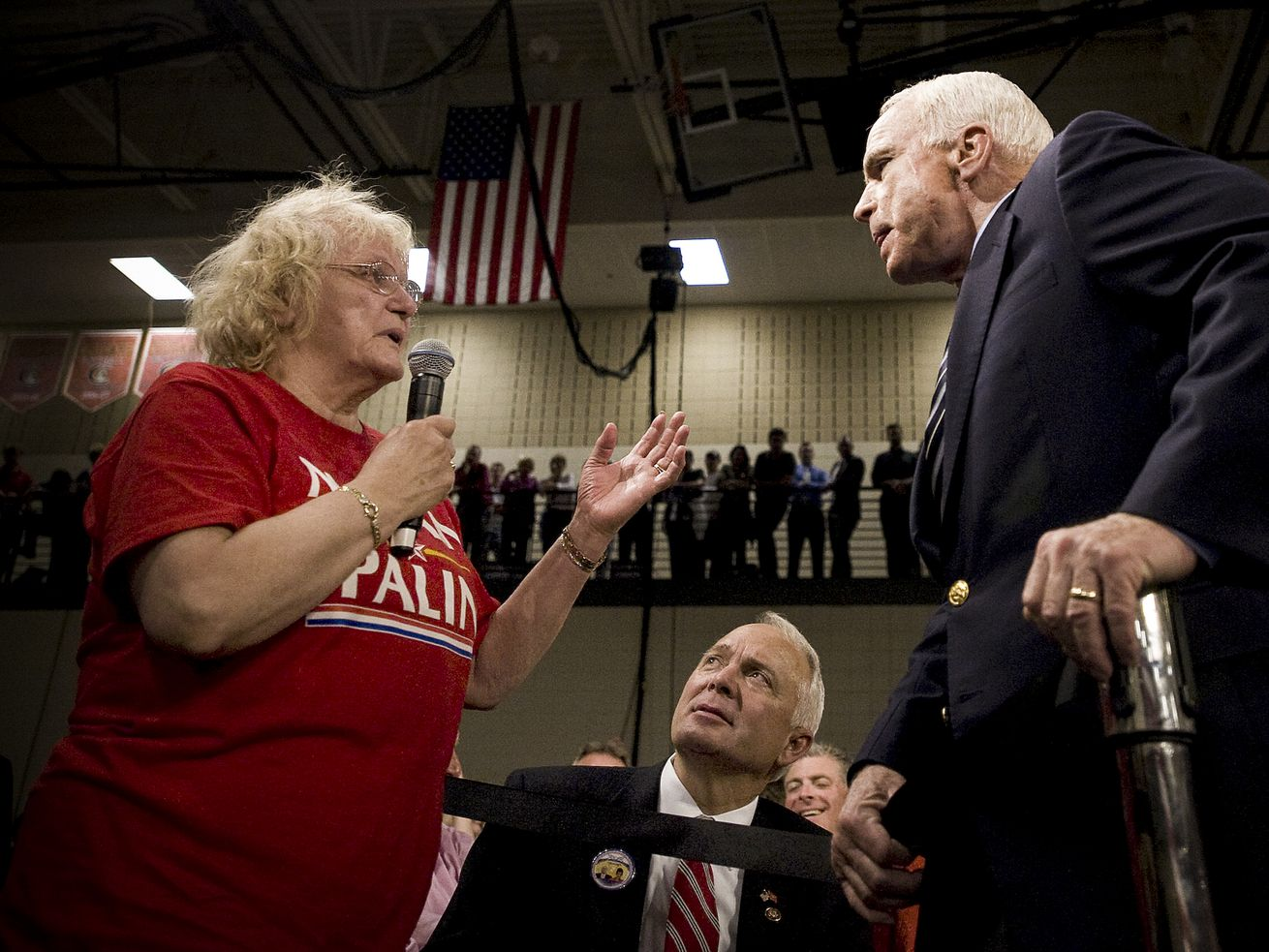 2008 Republican presidential candidate Sen. John McCain takes a question from a supporter, who called then-Democratic presidential candidate Barack Obama an Arab, during a town hall meeting in Lakeville, Minnesota, October 10, 2008. McCain urged his supporters to stop hurling abuse against Barack Obama at his rallies, saying he admired and respected his Democratic rival.