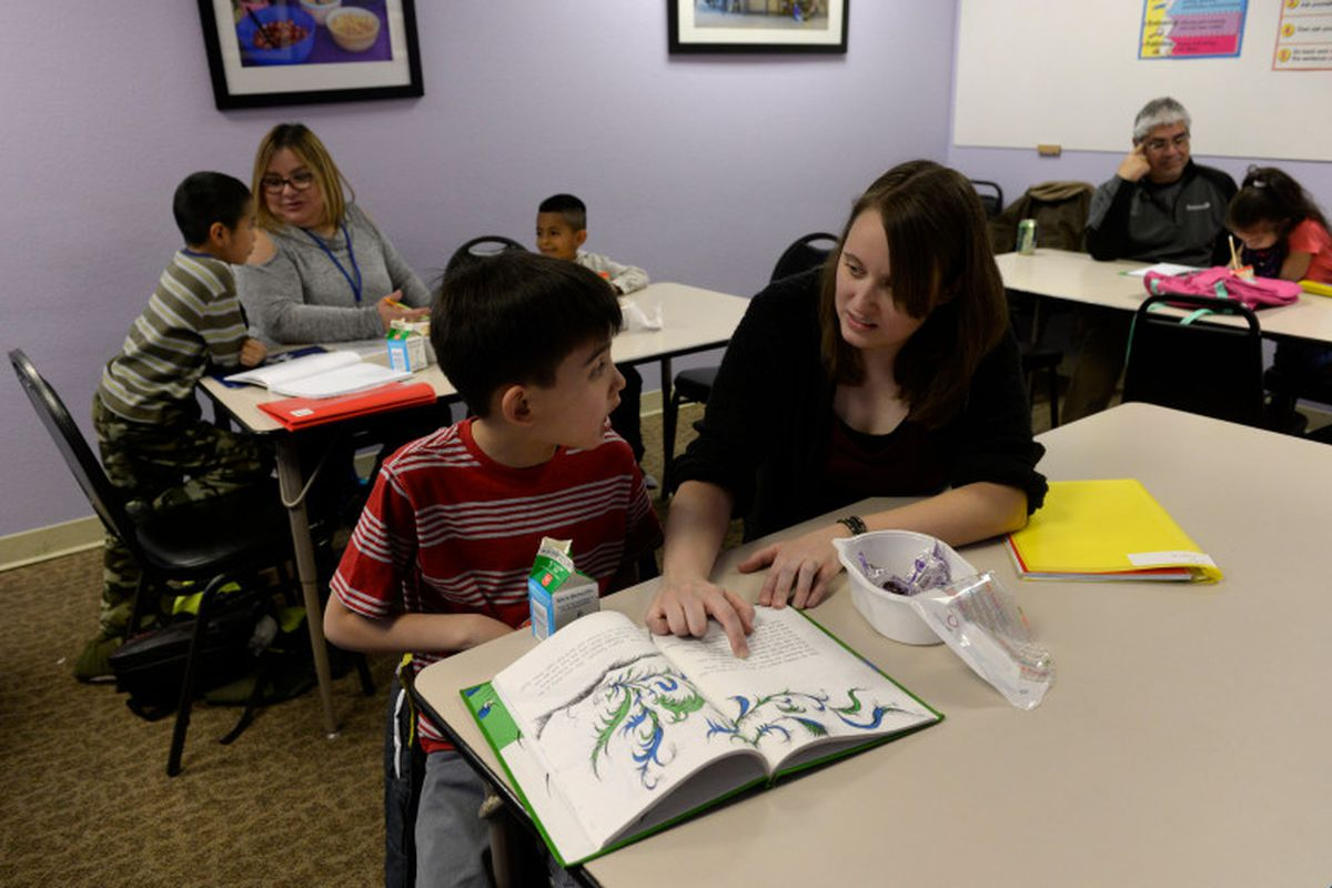 A reading lesson this spring at an Aurora family resource center. (Kathryn Scott, The Denver Post).
