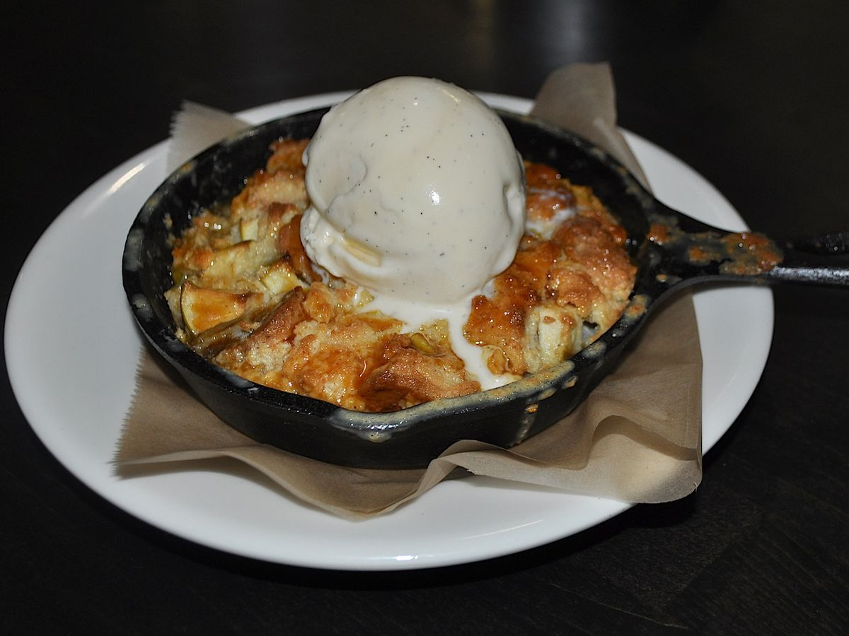 Cast-iron skillet tart topped with ice cream