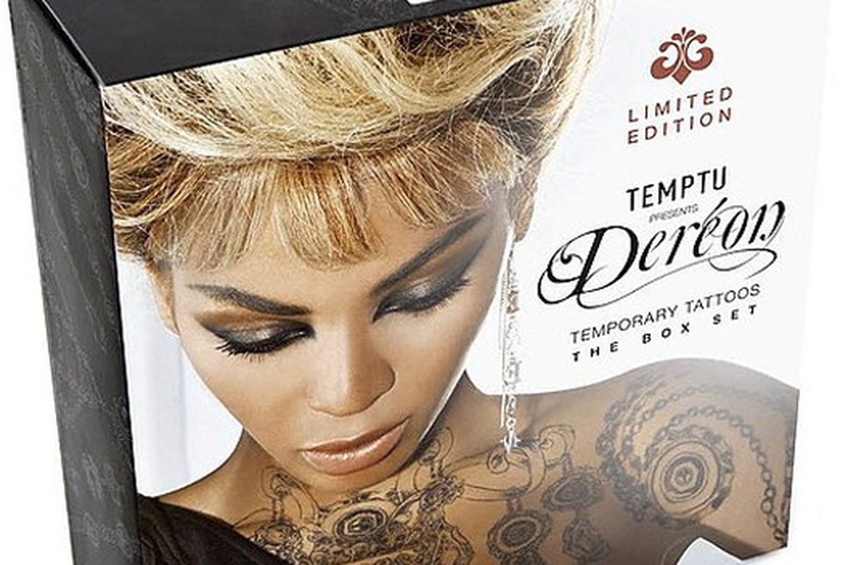 """Classy! And just in time for the holidays. Image via <a href=""""http://www.bellasugar.com/Beyonces-Faux-Tattoos-Out-Smaller-11517642"""">Bella Sugar</a>"""