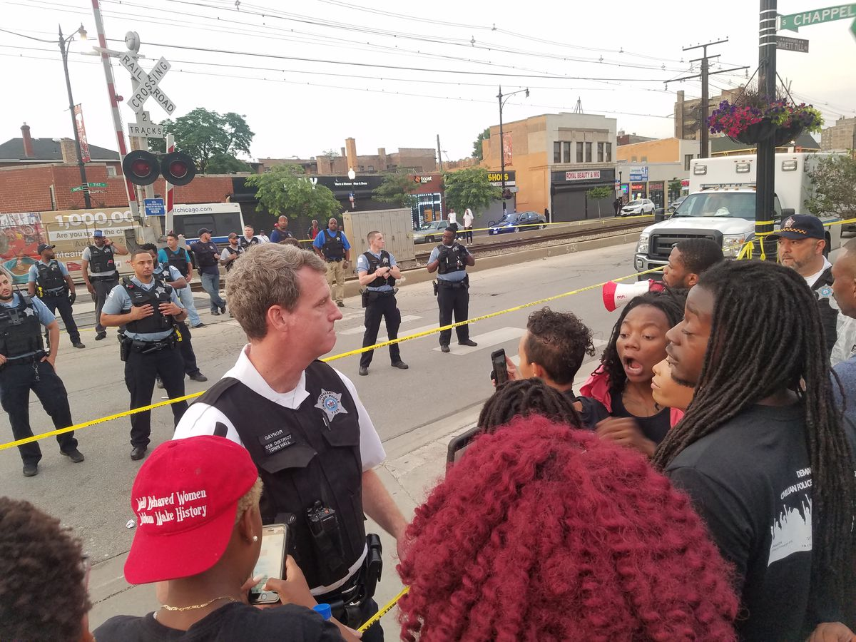 Police push back protesters near the scene where an officer fatally shot a man Saturday evening in South Shore. | Nader Issa/Sun-Times
